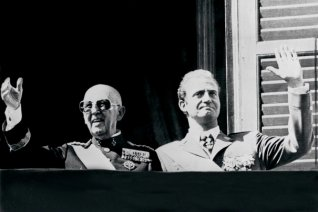 Spanish head of state General Francisco Franco (L) and prince Juan Carlos salute the crowd in Madrid in October 1975.