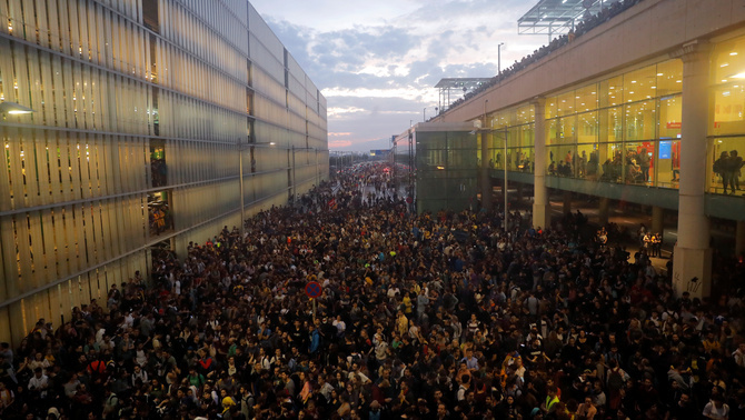 Protesters gather at Barcelona's airport, after a verdict in a trial over a banned independence referendum